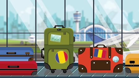 Suitcases with Romanian flag stickers on baggage carousel in airport, close-up. Tourism in Romania related illustration Imagens