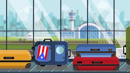 Suitcases with Puerto Rico flag stickers on baggage carousel in airport, close-up. Tourism related illustration Imagens