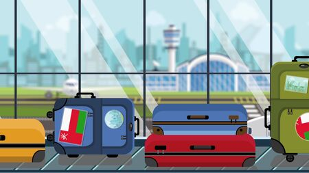 Suitcases with Oman flag stickers on baggage carousel in airport, close-up. Omani tourism related illustration