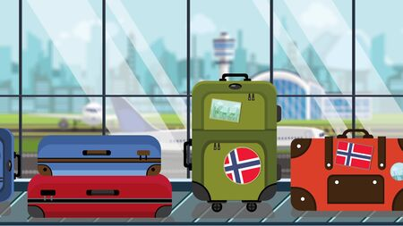 Luggage with Norwegian flag stickers on baggage carousel in airport, close-up. Tourism in Norway related illustration