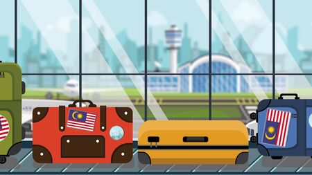 Baggage with Malaysian flag stickers on carousel in airport, close-up. Travel to Malaysia related illustration Imagens