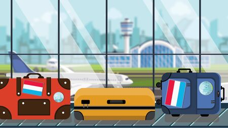 Suitcases with Luxembourgian flag stickers on baggage carousel in airport, close-up. Tourism in Luxembourg related illustration