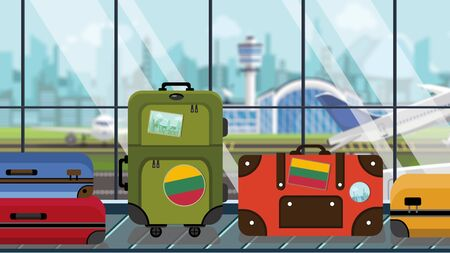 Suitcases with Lithuania flag stickers on baggage carousel in airport, close-up. Lithuanian tourism related illustration