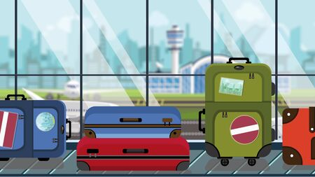 Suitcases with Latvian flag stickers on baggage carousel in airport, close-up. Travel to Latvia related illustration