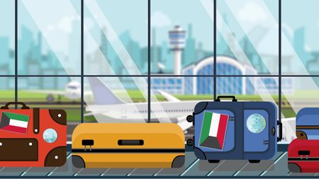 Suitcases with Kuwait flag stickers on baggage carousel in airport, close-up. Kuwaiti tourism related illustration