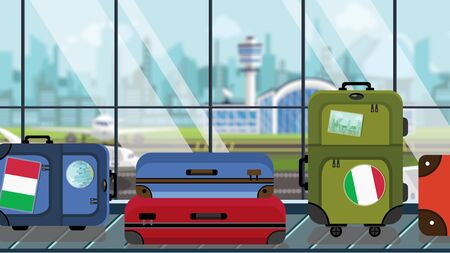 Suitcases with Italian flag stickers on baggage carousel in airport, close-up. Tourism in Italy related illustration