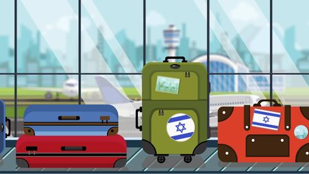 Suitcases with Israel flag stickers on baggage carousel in airport, close-up. Israeli tourism related illustration Imagens