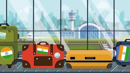 Suitcases with Indian flag stickers on baggage carousel in airport, close-up. Tourism in India related illustration Stock Photo