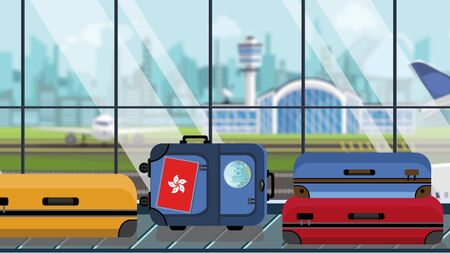Suitcases with Hong Kong flag stickers on baggage carousel in airport, close-up. Tourism related illustration