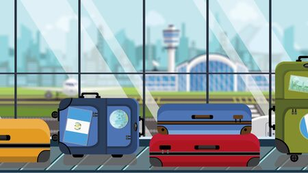 Suitcases with Guatemala flag stickers on baggage carousel in airport, close-up. Guatemalan tourism related illustration