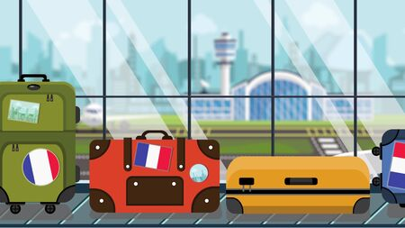 Suitcases with France flag stickers on baggage carousel in airport, close-up. French tourism related illustration