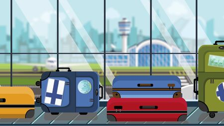 Suitcases with Finnish flag stickers on baggage carousel in airport, close-up. Tourism in Finland related illustration Stock Photo