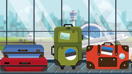 Baggage with Estonian flag stickers on carousel in airport, close-up. Travel to Estonia related illustration
