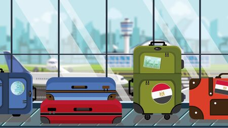 Suitcases with Egyptian flag stickers on baggage carousel in airport, close-up. Travel to Egypt related illustration
