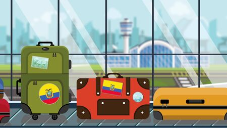 Luggage with Ecuadorian flag stickers on baggage carousel in airport, close-up. Tourism in Ecuador related illustration
