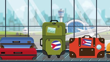 Suitcases with Cuban flag stickers on baggage carousel in airport, close-up. Tourism in Cuba related illustration