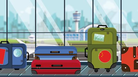 Suitcases with China flag stickers on baggage carousel in airport, close-up. Chinese tourism related illustration
