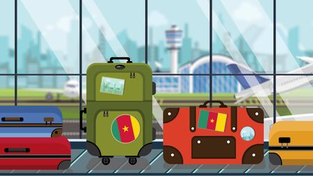 Suitcases with Cameroonian flag stickers on baggage carousel in airport, close-up. Travel to Cameroon related illustration Stock Photo