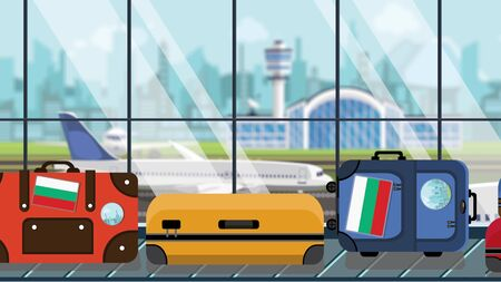 Suitcases with Bulgarian flag stickers on baggage carousel in airport, close-up. Tourism in Bulgaria related illustration Imagens