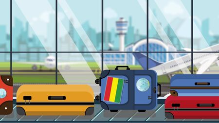 Baggage with Bolivian flag stickers on carousel in airport, close-up. Tourism in Bolivia related illustration