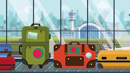 Luggage with Bangladeshi flag stickers on baggage carousel in airport, close-up. Tourism in Bangladesh related illustration