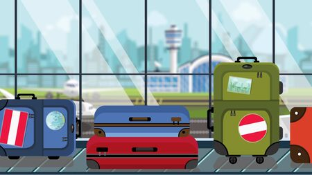 Suitcases with Austrian flag stickers on baggage carousel in airport, close-up. Tourism in Austria related illustration