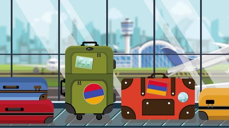 Baggage with Armenian flag stickers on carousel in airport, close-up. Tourism in Armenia related illustration