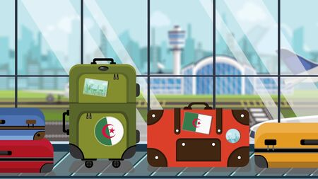 Suitcases with Algerian flag stickers on baggage carousel in airport, close-up. Travel to Algeria related illustration