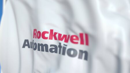 Flying flag with Rockwell Automation logo, close-up. Editorial 3D rendering