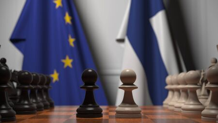 Flags of the EU and Finland behind chess board. The first pawn moves in the beginning of the game. Political rivalry conceptual 3D rendering
