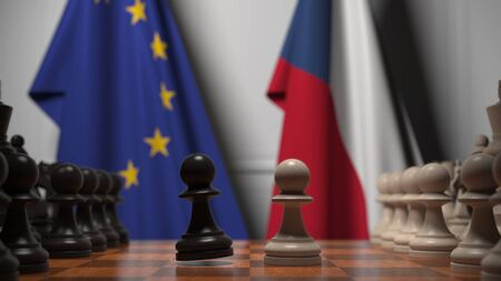 Flags of the EU and the Czech Republic behind chess board. The first pawn moves in the beginning of the game. Political rivalry conceptual 3D rendering Stockfoto
