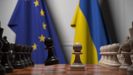 Flags of the EU and Ukraine behind chess board. The first pawn moves in the beginning of the game. Political rivalry conceptual 3D rendering Stockfoto