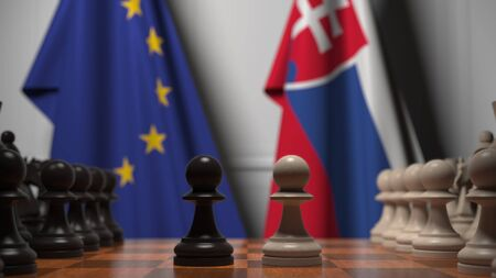 Flags of the EU and Slovakia behind chess board. The first pawn moves in the beginning of the game. Political rivalry conceptual 3D rendering Stockfoto