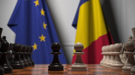 Flags of the EU and Romania behind chess board. The first pawn moves in the beginning of the game. Political rivalry conceptual 3D rendering