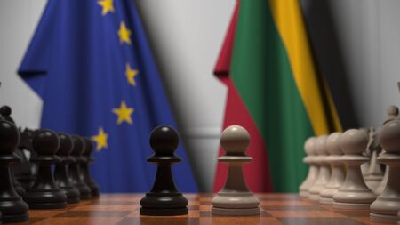 Flags of the EU and Lithuania behind chess board. The first pawn moves in the beginning of the game. Political rivalry conceptual 3D rendering Stockfoto