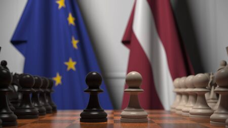 Flags of the EU and Latvia behind chess board. The first pawn moves in the beginning of the game. Political rivalry conceptual 3D rendering Stockfoto