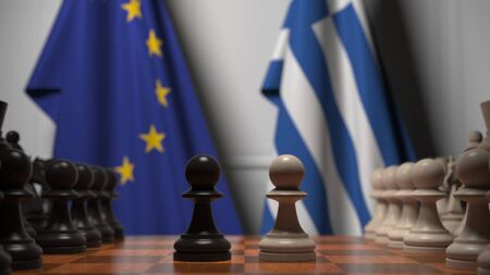 Flags of the EU and Greece behind chess board. The first pawn moves in the beginning of the game. Political rivalry conceptual 3D rendering Stockfoto
