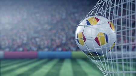 Flag of Romania on the ball in football net. Conceptual 3D rendering