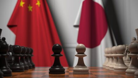 Flags of China and Japan behind chess board. The first pawn moves in the beginning of the game. Political rivalry conceptual 3D rendering
