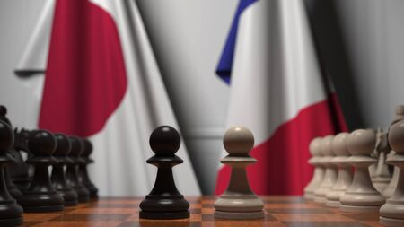 Flags of Japan and France behind chess board. The first pawn moves in the beginning of the game. Political rivalry conceptual 3D rendering