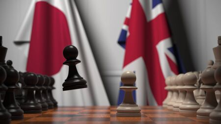 Flags of Japan and Great Britain behind chess board. The first pawn moves in the beginning of the game. Political rivalry conceptual 3D rendering