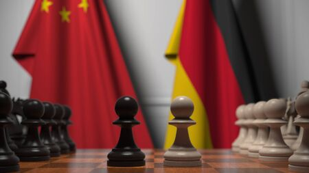 Flags of China and Germany behind chess board. The first pawn moves in the beginning of the game. Political rivalry conceptual 3D rendering