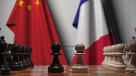 Flags of China and France behind chess board. The first pawn moves in the beginning of the game. Political rivalry conceptual 3D rendering Stockfoto