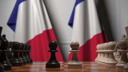 Flags of France behind chess board. The first pawn moves in the beginning of the game. Political rivalry conceptual 3D rendering Stockfoto