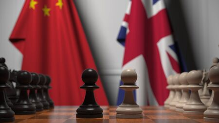 Flags of China and the UK behind chess board. The first pawn moves in the beginning of the game. Political rivalry conceptual 3D rendering