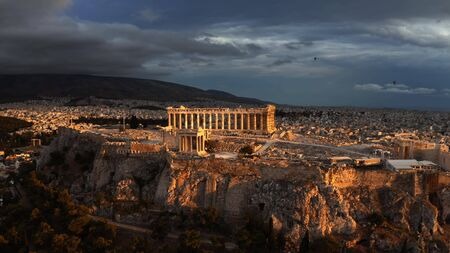 Aerial view of the Parthenon temple on Acropolis of Athens at beautiful sunset. Greece