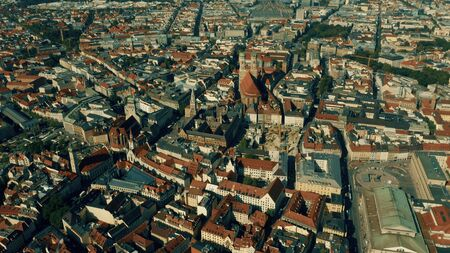 Aerial view of Munich involving famous Marienplatz square with Neues Rathaus building and Frauenkirche church, Germany