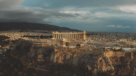 Parthenon temple on Acropolis of Athens at beautiful sunset, aerial view. Greece
