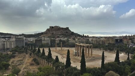 Low altitude aerial shot of the Temple of Olympian Zeus and famous Acropolis in Athens, Greece