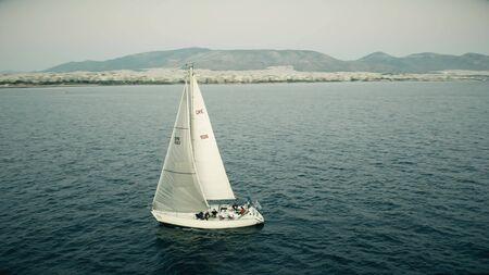 ATHENS, GREECE - SEPTEMBER 28, 2019. Aerial shot of a sailing yacht at sea